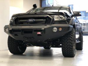 Black 4x4 Ford SUV with rocker bar no loop